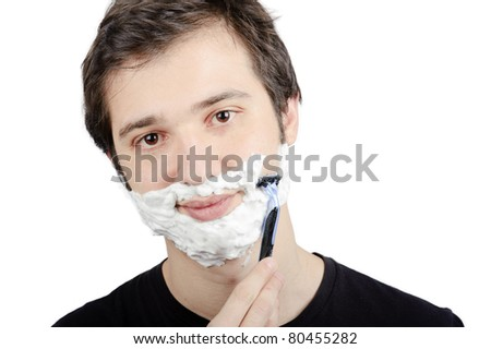 young man shaving himself portrait isolated on white background - stock photo