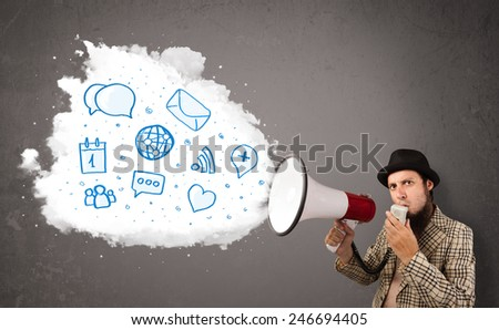 Young man shouting into loudspeaker and modern blue icons and symbols come out - stock photo