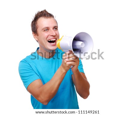 Young man shouting loud into the megaphone