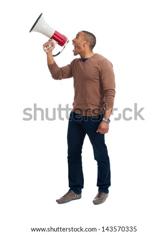Young Man Shouting Through Megaphone Over White Background - stock photo