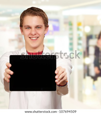 Young Man Showing Digital Tablet, Indoor - stock photo