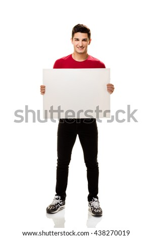 Young man showing empty placard. - stock photo