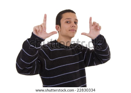 Young man showing framing hand gesture on an isolated background