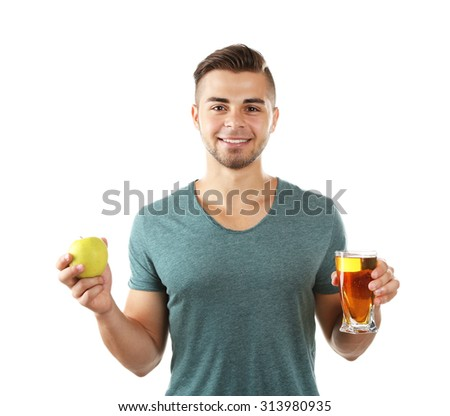 Young man showing glass of apple juice, isolated on white - stock photo