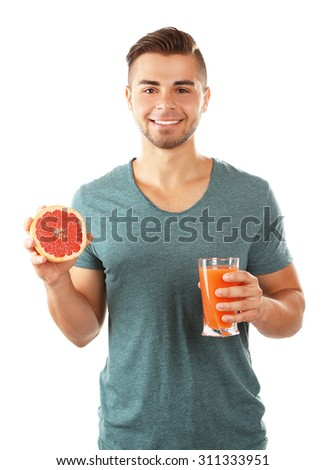Young man showing glass of grapefruit juice, isolated on white