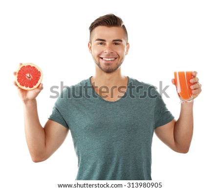 Young man showing glass of grapefruit juice, isolated on white - stock photo