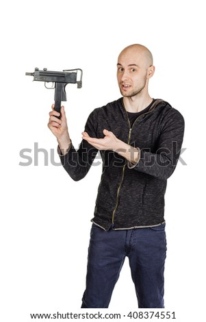 young man showing handgun, isolated over white background