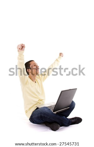 young man showing his success working with a laptop - stock photo