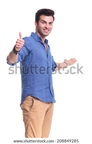 young man showing something and making the ok thumbs up hand sign - stock photo