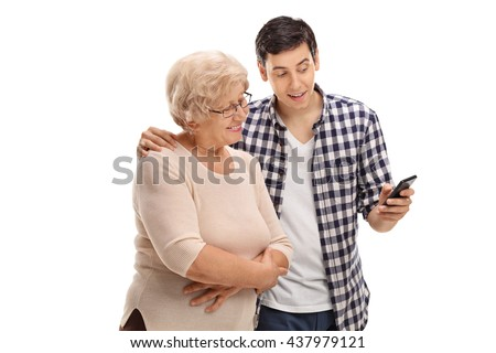 Young man showing something to an elderly woman on his cell phone isolated on white background