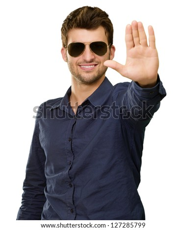 Young Man Showing Stop Sign On White Background