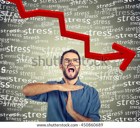 Young man showing time out hand gesture, frustrated screaming to stop stress isolated on gray wall background. Too many things to do. Human emotions face expression reaction feelings  - stock photo