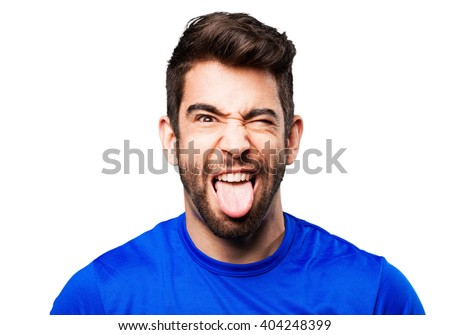 young man showing tongue - stock photo