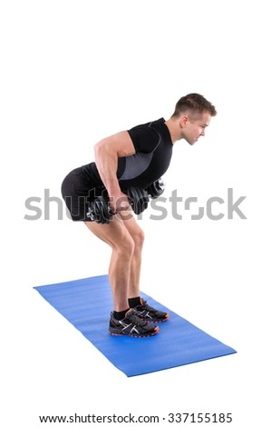 Young man shows finishing position of Standing Bent Over Dumbbells Row workout, isolated on white - stock photo