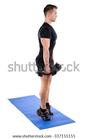 Young man shows finishing position of Standing Dumbbell Calf Raise with Dumbbels workout, isolated on white - stock photo