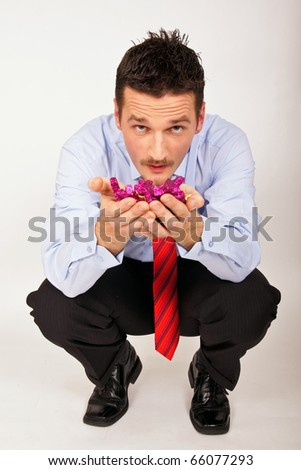 Young man shows violet Christmas stars for you. - stock photo