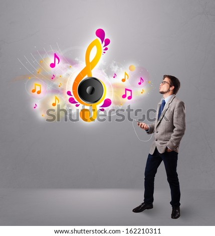 young man singing and listening to music with musical notes getting out of his mouth - stock photo