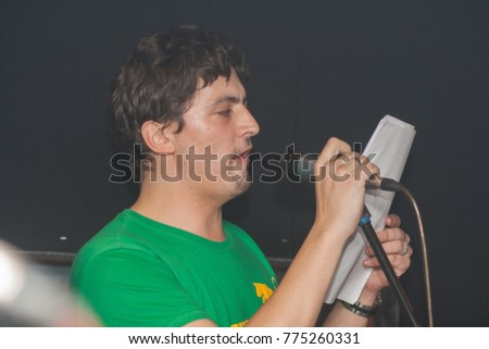 Young man singing in the studio