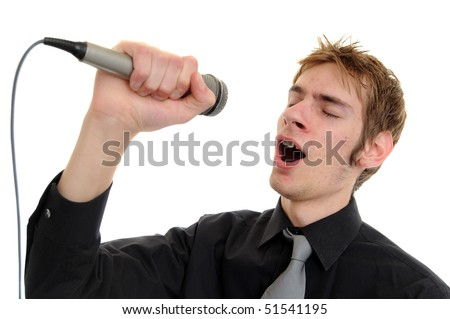 Young man sings into a karaoke microphone isolated on white - stock photo
