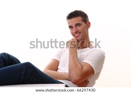 young man sitting at the table an smilling