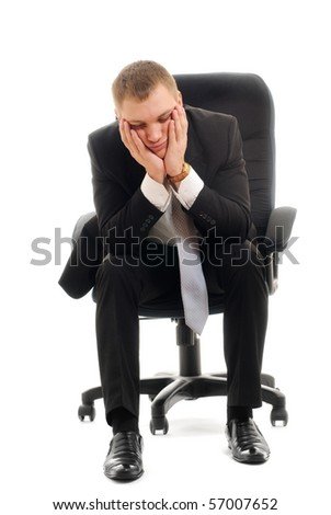 Young man sitting in chair. Isolated over white. - stock photo