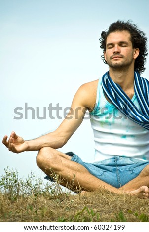 Young man sitting in lotus position