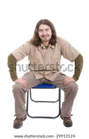 Young man sitting on a chair, isolated over white - stock photo