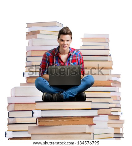 Young man sitting on a stack of books with a laptop,white background