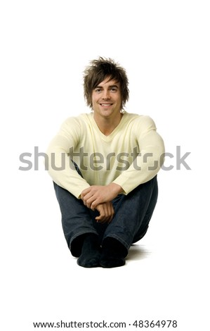 young man sitting smiling isolated on a white background