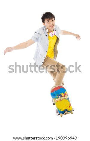 young man Skateboard to jump isolated on white background - stock photo