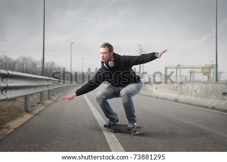 Young man skating on a street - stock photo