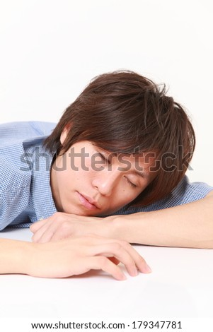 Young Man Sleeping on the Table