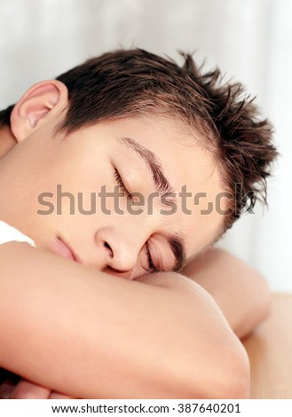 Young Man Sleeping on the Table closeup