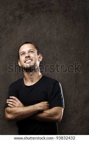 young man smiling against a grunge background - stock photo