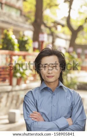 Young man smiling and looking at camera - stock photo
