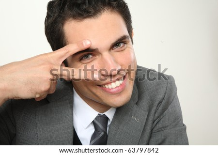 young man smiling and showing - stock photo
