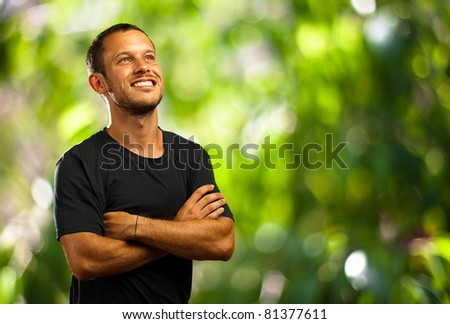 young man smiling in the park - stock photo