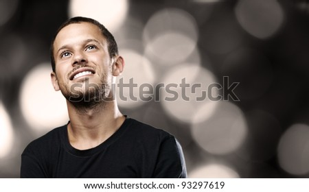 young man smiling on a lights background
