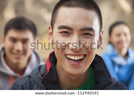 Young man smiling, portrait - stock photo