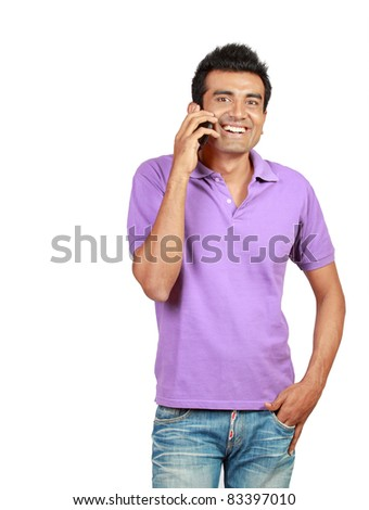 Young man smiling using a mobile phone as a mode of communication - stock photo