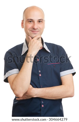 young man smiling with hand on chin. Isolated - stock photo