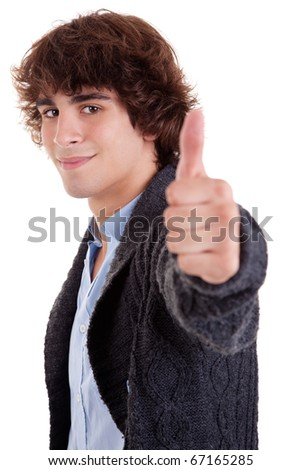 young man smiling, with thumb up, isolated on white, studio shot - stock photo