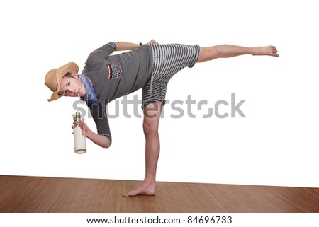 Young man smokes while exercising over white background