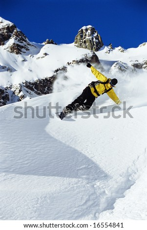 Young man snowboarding - stock photo