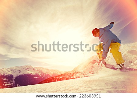 Young man snowboarding. - stock photo