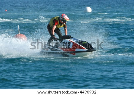 Young man speeding on jet ski