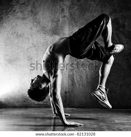 Young man sports exercises. Contrast black and white. - stock photo