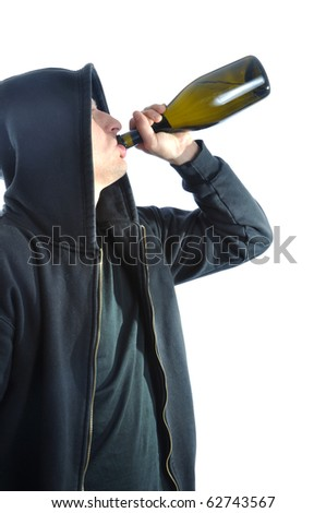 Young man, standing and drinking alcohol, isolated on white background - stock photo
