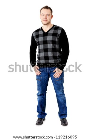 Young man standing casually - stock photo