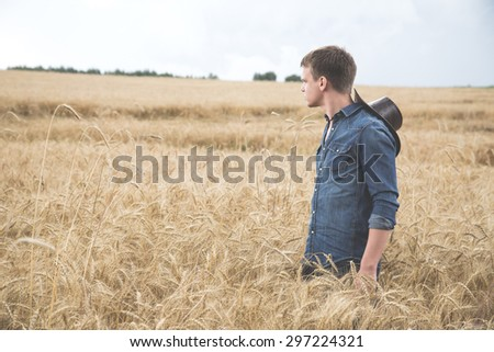 Young man standing in a field